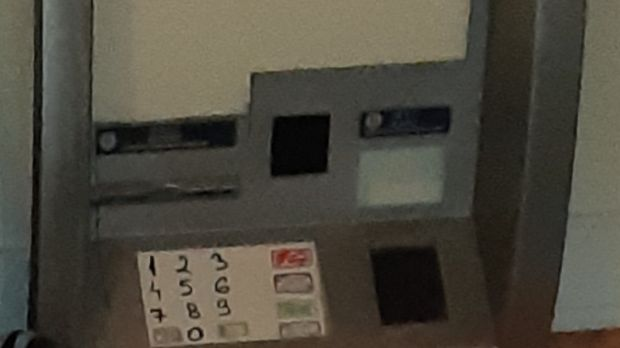 The fake ATM screen placed over the front of ATM machines to skim data from bank cards. (Note: the key pad numerals were written in by gardaí for illustrative purposes). Photograph: An Garda