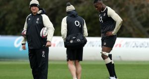 Maro Itoje with England physio Bob Stewart and Richard Hill, the team manager. Photograph: David Rogers/Getty Images