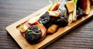 Traditional black pudding is a blend of meat, oatmeal or barley, herbs and spices and the quintessential fresh blood