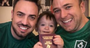 Jay O'Callaghan, his husband Aaron O'Bryan, and their son Jake with his new Irish passport.