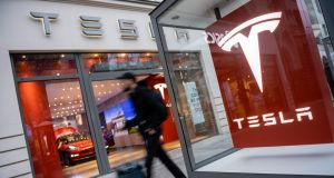 Elon  Musk described the winding down of many stores as a cost-cutting move that enables Tesla to offer a long-promised $35,000 version of the Model 3. Photograph:  Jens Schlueter/EPA