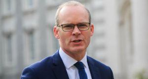 Tánaiste and Minister for Foreign Affairs and Trade, Simon Coveney speaks to the media during a press brieifing in the courtyard of Government Buildings in Dublin on Tuesday. Photograph: Gareth Chaney/Collins