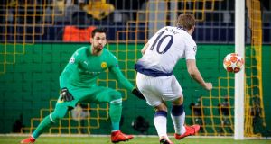 Harry Kane scores Tottenham Hotspur's goal during the Champions League round of 16 second leg against Borussia Dortmund at the Westfalen Stadium. Photograph: Ronald Wittek/EPA