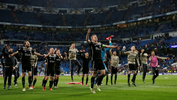 Matthijs de Ligt leads the Ajax celebrations after the 4-1 victory over Real Madrid in the Champions League round of 16 second leg at the Santiago Bernabéu stadium. Photograph: Susana Vera/Reuters