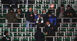 Fans begin to gather in the standing area at Celtic Park. Photograph: Mike Hewitt/Getty Images