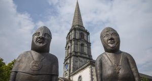 Statues of Strongbow and Aoife flank Christ Church Cathedral in Waterford, designed by John Roberts.