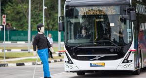 Dummy on a scooter tests the response of a self-driving Volvo bus on trial in Singapore. Photograph: Ore Huiying/Bloomberg