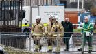 Police, Fire and Rescue and Bomb disposal teams investigate a suspicious package reported to be in the Glasgow University mailroom, in Glasgow on Wednesday. Photograph. Robert Perry/EPA