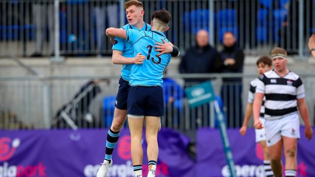 Chris Cosgrave (#13) celebrates scoring a try with St Michael's team-mate Mark O'Brien during the Leinster Schools' Senior Cup semi-final at Donnybrook. Photograph: Tommy Dickson/Inpho