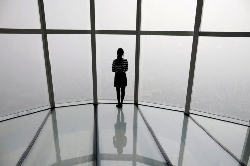 SEOUL: A woman looks at a view of Seoul shrouded by fine dust caused by pollution in South Korea. Photograph: Kim Hong-Ji/Reuters