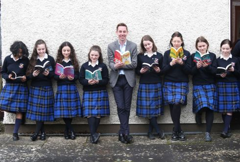 BOOKWORMS: Broadcaster Ryan Tubridy with students from St Raphaela's Secondary School, Stillorgan at the launch of Children's Books Ireland's school libraries campaign. Photograph: Leon Farrell/Photocall Ireland