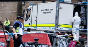 Police and bomb disposal teams investigate a package sent to Glasgow University. Photograph: Robert Perry/EPA