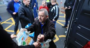 Fans donate food to a foodbank outside the ground ahead of the Premier League match between Liverpool and Everton at Anfield on December 2nd 2018 in Liverpool. Photograph:  Simon Stacpoole/Offside/Getty Images