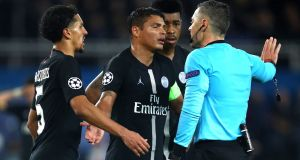 Thiago Silva remonstrates with the referee after a penalty is awarded to Manchester United. Photograph: Julian Finney/Getty Images