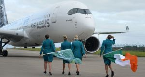 Aer Lingus staff welcome the arrival of first Aer Cap Airbus A350 at Dublin Airport. Photograph: Dara Mac Dónaill