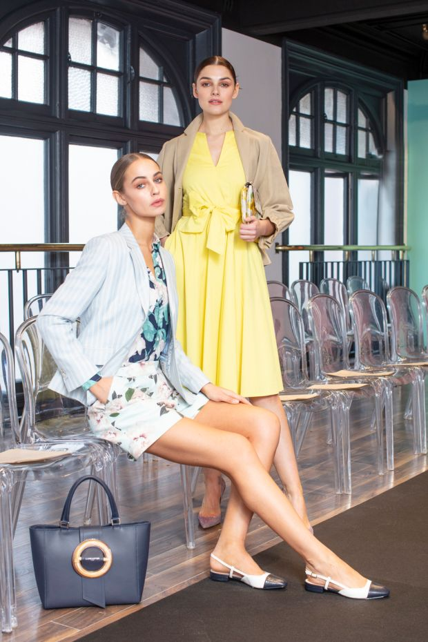 Kelli wears a beige jacket, Caractère, €260, a yellow cotton dress, Max & Co, €180 and a jacquard floral clutch, Olga Berg, €62 and Thalia wears a blue striped blazer, Magee, €275, a floral print shirt, Gant, €110, floral shorts, Ted Baker, €155 and a navy bag, Lancaster, €239, pictured at the Arnotts SS19 show. Photograph: Anthony Woods