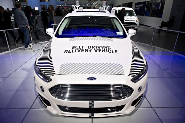 A Ford Motor Co Fusion set-up as an experimental self-driving delivery vehicle sits on display during the 2018 North American International Auto Show in Detroit, Michigan January 15th, 2018. Photographer: Daniel Acker/Bloomberg/Getty
