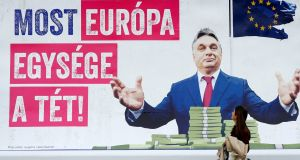 "A  2018 billboard showing Hungary's prime minister, Viktor Orban, which reads, ""First he just wanted to take our money, now the unity of Europe is at stake"", outside the European Parliament in Brussels. Photograph:  Francois Lenoir/Reuters"