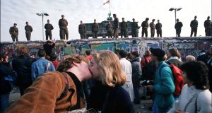 Germans celebrate as the Berlin Wall is opened in November 1989. Had you asked which countries would benefit most from the collapse of communism, Ireland wouldn't have featured. Photograph: Patrick Piel/Gamma-Rapho via Getty Images