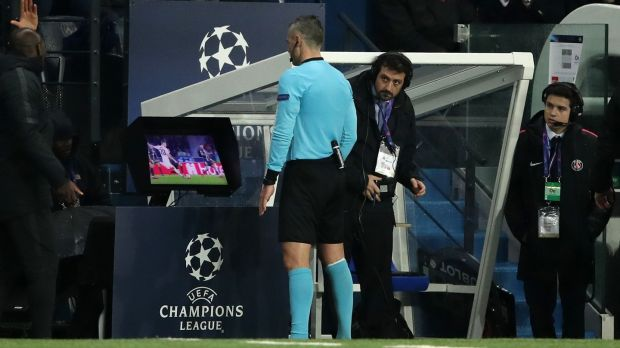 Match referee Damir Skomina studies the VAR System prior to awarding Manchester United a penalty during the Champions League match at the Parc des Princes. Photograph: John Walton/PA Wire