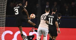 Paris Saint-Germain defender Presnel Kimpembe is struck on the arm by a shot from Manchester United's Diogo Dalot's  during the game at the Parc des Princes. Photograph:   Franck Fife/AFP/Getty Images