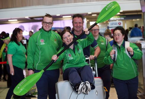 Kayaking coach Angelina Foley is pushed by her team at Dublin Airport as Team Ireland depart for the 2019 Special Olympics World Summer Games in Abu Dhabi. Photograph: Laura Hutton/The Irish Times