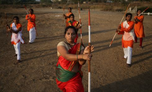 Women practise Shivkalin Yuddha Kala, a martial art from the state of Maharashtra in western India, on the outskirts of Mumbai, ahead of International Women's Day. Photograph: Francis Mascarenhas/Reuters