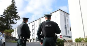 Police outside  Glin Ree Court in Newry, Co Down, where the bodies of a man, a woman and a teenage girl were discovered on Thursday.  Photograph:  Niall Carson/PA