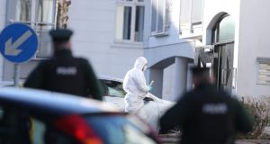 Police forensic officers at Glin Ree Court in Newry, Co Down, where the bodies of a man, a woman and a teenage girl were discovered in a flat on Thursday morning. Phototgraph: Niall Carson/PA Wire