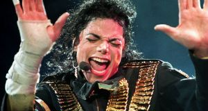 Michael Jackson performs in Singapore, during his 1993 Dangerous tour. Photograph:  STR/AFP/Getty Images