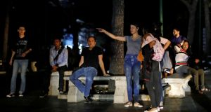 People gather at the park during a blackout in Caracas, Venezuela on Thursday.  Photograph: Carlos Jasso/Reuters