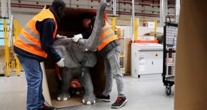 Amazon employees pack a model elephant in special packaging at the Amazon logistic and distribution center. The United States' strong run of uninterrupted jobs growth came to a near halt in February,  department of labour data showed. Photograph: Friedemann Vogel/EPA