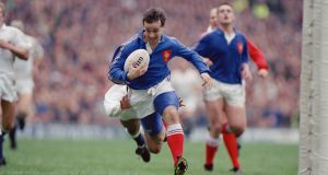 Philippe Saint-André of France about to score a try during the last match of the Five Nations tournament at Twickenham in March 1991. England won the match 21-19. Photograph: Simon Bruty/Getty Images