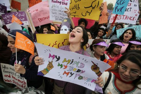A woman carries a sign and chants slogans during a rally to mark International Women's Day in Lahore, Pakistan. REUTERS/Mohsin Raza