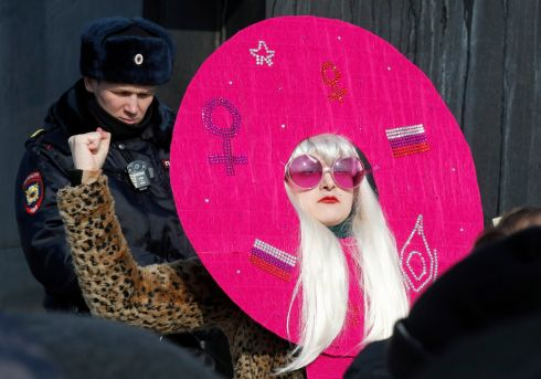 A woman attends a rally in St. Petersburg, Russia, in honor of International Women's Day.   EPA/ANATOLY MALTSEV