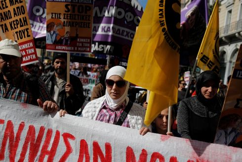 Syrian refugees take part in a march marking International Women's Day in Athens, Greece. REUTERS/Costas Baltas