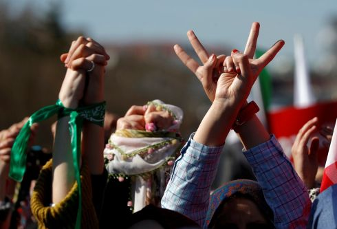 Demonstrators hold up their hands during a rally in solidarity with Syrian women, in Istanbul, Turkey. REUTERS/Murad Sezer