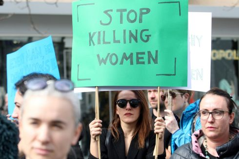 Women's rights activists wearing black as a sign of mourning for the victims of violence hold posters condemning violence against women during a rally in downtown Tirana, Albania. REUTERS/Florion Goga