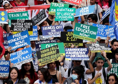 Filipino women and supporters hold placards during a rally marking International Women's Day in Manila, Philippines.  EPA/FRANCIS R. MALASIG