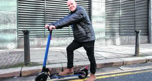 Conor Pope test drives an electric scooter on the streets of Dublin. Photograph: Dave Meehan/The Irish Times
