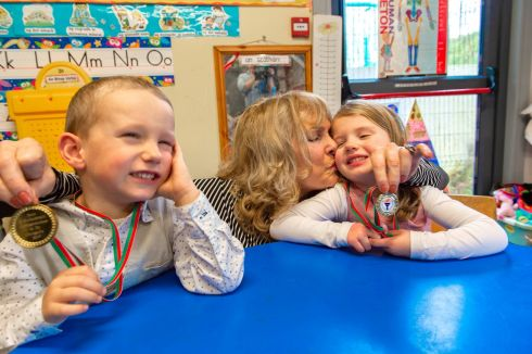 Ruth Clarke with her grandchildren, four-year-old twins Sean and Emma O'Sullivan who were hailed for saving her life. Ms Clarke fell unconscious while taking care of the twins, who then used her phone to call for assistance from their grandfather. They then unlocked the front door to let him in. The twins' school, Naíonra Gaelscoil Clonakilty, Co Cork, awarded them 'Bravery Medals' for their actions. Photograph: Michael Mac Sweeney/Provision