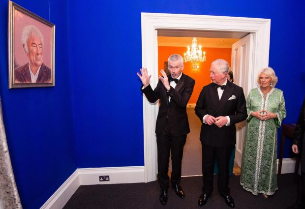 Adrian O'Neill (left), Ireland's Ambassador to the UK, shows a portrait of Seamus Heaney by artist Mark Baker to Prince Charles, Prince of Wales and Camilla, Duchess of Cornwall as they attend a dinner to mark St Patrick's Day and celebrate UK-Irish relations on March 6th in London, United Kingdom. Photograph: Jeff Spicer/Getty