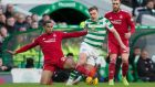 James Forrest is tackled by Max Lowe during Celtic's goalless draw with Aberdeen. Photograph: Jeff Holmes/PA
