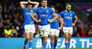 Dave Sisi and teammates look dejected during Italy's heavy defeat to England at Twickenham. Photograph: Michael Steele/Getty