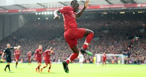 Sadio Mané of Liverpool celebrates scoring his side's second goal during the Premier League match between Liverpool and Burnley at Anfield. Photo: Michael Regan/Getty Images