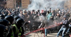 Far-right demonstrators clashing with riot police outside the presidential administration building in Kiev on  March 9th. Photograph: Serhii Nuzhnenko/Radio Free Europe/Radio Liberty via AP