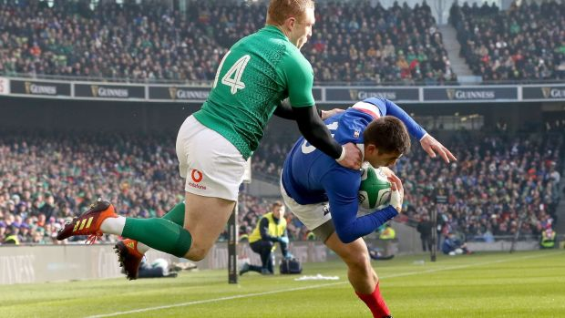 Thomas Ramos gathers the ball under pressure from Keith Earls. Photo: Paul Faith/Getty Images