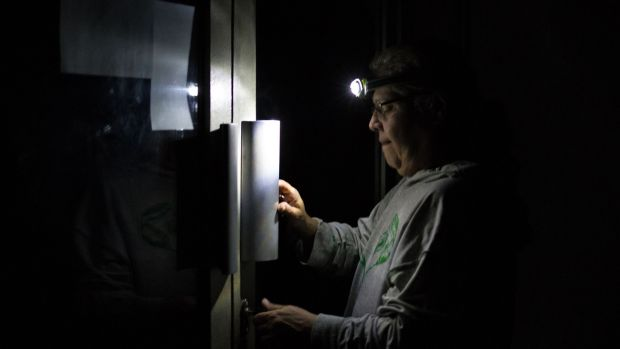 A man enters a Caracas residential building in darkness. Sunday is the third day Venezuelans remain without communications, electricity or water, in an unprecedented power outage. Photograph: Cristian Hernandez/AFP/Getty Images