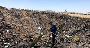 A man inspectings  wreckage at the crash site of an Ethiopia Airlines aircraft  southeast of Addis Ababa, Ethiopia. Photograph:  Ethiopian Airlines/AFP/Getty