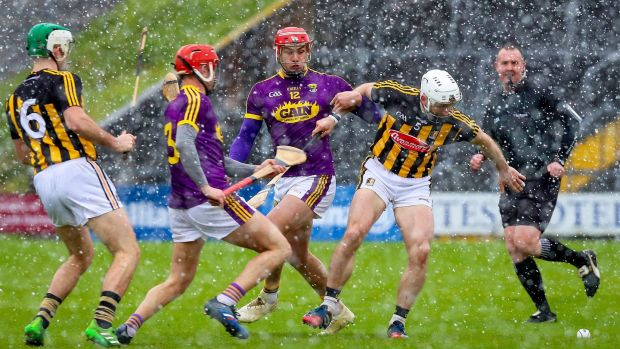 Lee Chin and Conor Fogarty in action at Wexford Park. Photograph: Tommy Dickson/Inpho